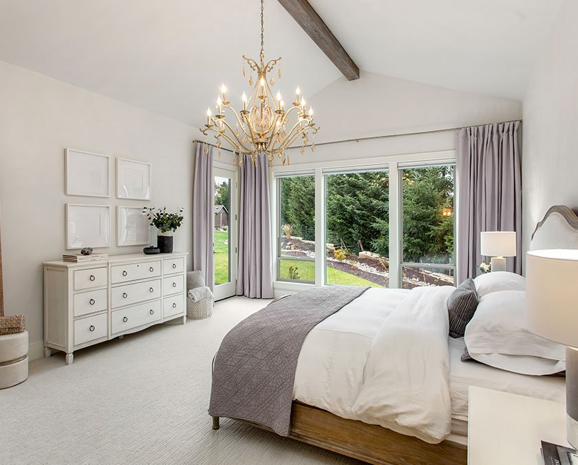 New bedroom with large windows and high ceiling