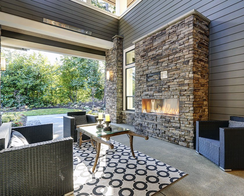 Outdoor living space with chimney and sitting area